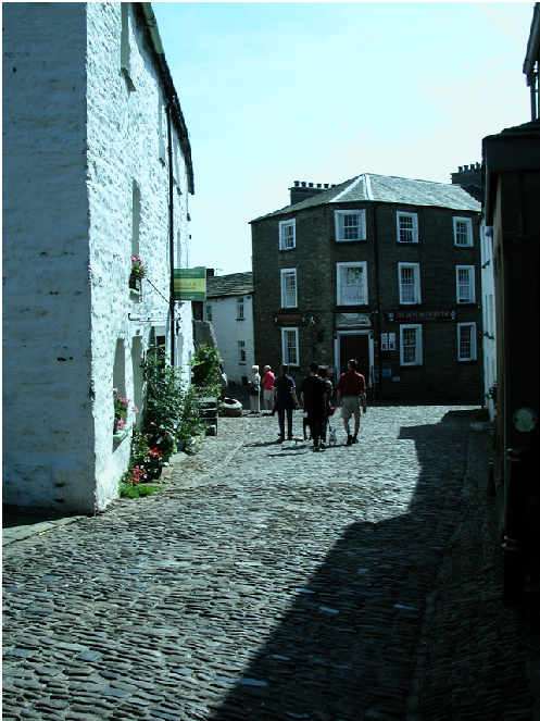 Looking down the cobbles to the George and Dragon pub..png