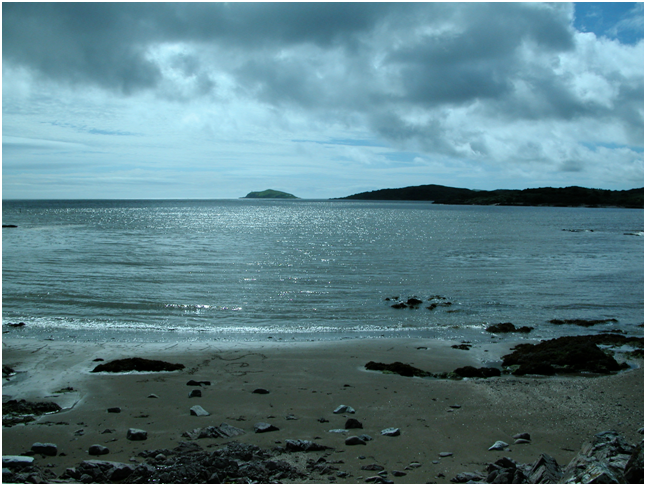 Looking out from Rockcliffe, with Rough Island nearest to the shore and Hestan Island the the distance.png