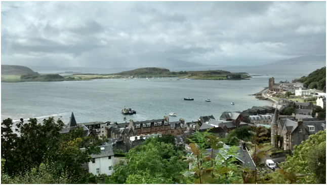 The view out from McCaig's Tower, with Mull a dark smudge on the horizon..png