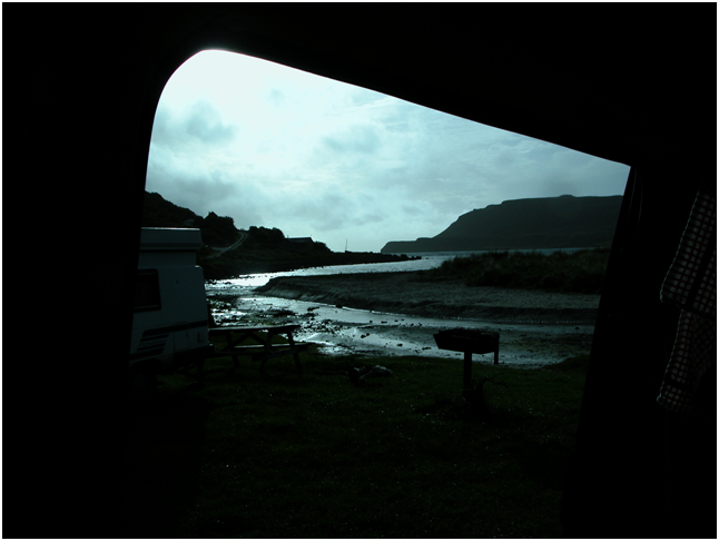 Looking out of the 'van in the twilight, watching the tide come up the little estuary and the weird play of sea versus river water..png