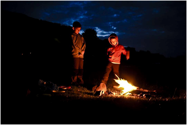 Wild kids are happy kids. Michal and Martin by the last campfire of their trip..png